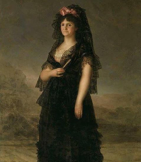 Este vestido largo en gasa de algodón mercerizado se inspiró en el retrato de la Reina María Luisa con mantilla