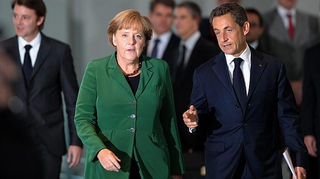 Merkel y Sarkozy pactan recapitalizar la banca y readaptar tratados de la UE