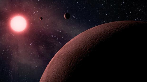 Representación artística del sistema solar de una estrella enana roja