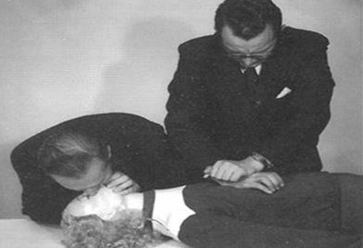 Asmund Laerdal and Bjorn Lind demonstrate CPR in the original Resusci Anne