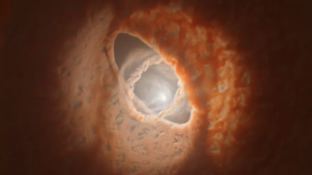 En la ilustración, los tres anillos de polvo y fas, desalineados, rodean el sistema estelar triple GW Orionis
