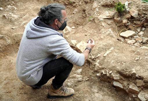 Ocharan examines a piece on the esplanade next to the sanctuary