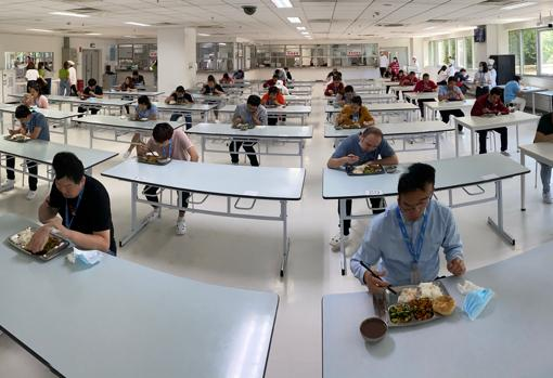 Renesas semiconductor factory in Beijing. To avoid contagion of the coronavirus, the social distancing is kept in the canteen with one employee per table