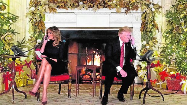 Melania y Donald Trump durante una recogida de fondos en Navidad de 2018