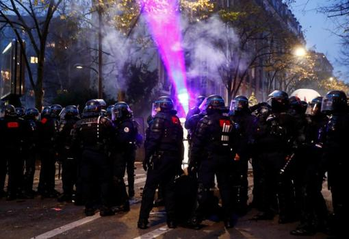 Police officers confront protesters in the French capital