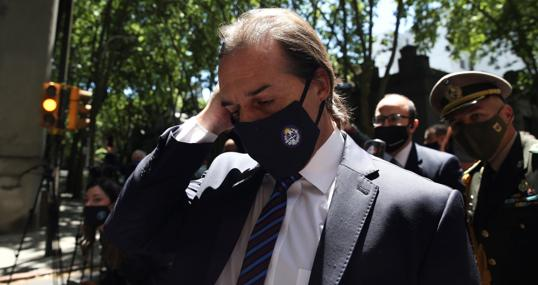 The president of Uruguay, Luis Lacalle Pou, attends the funeral home to express his condolences to the family of former president Tabaré Vázquez