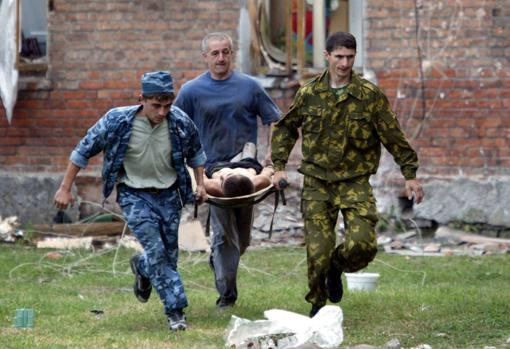 Beslan terrorist attack.  A boy is rescued from the attacked school